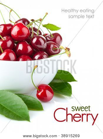 fresh cherry berries with green leaf isolated on white background