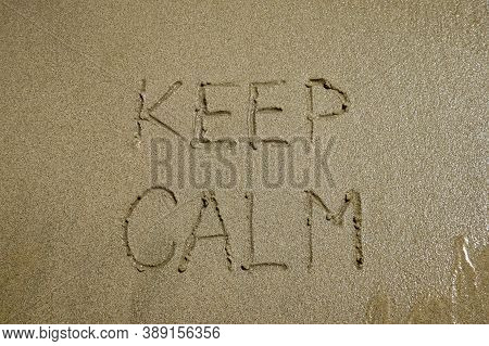 The Sign Keep Calm Written On Sand, Stress Free Concept