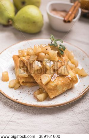Apple Pancake. Thin Pancakes (crepes) With Apple Filling, Stuffed Rolls, Russian Traditional Food Fo