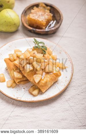 Apple Pancake.thin Pancakes (crepes) With Apple Filling, Stuffed Rolls, Russian Traditional Food For
