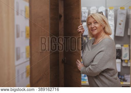 Happy Mature Housewife Shopping For Furniture, Copy Space. Lovely Mid-aged Female Customer Enjoying