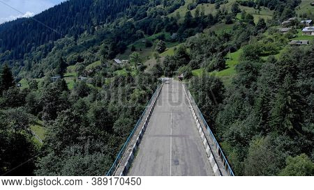 High Altitude Asphalt Road In Mountains. Beautiful Scenery Of Untouched Nature And Concrete Road.
