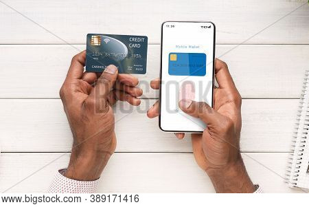 Online Payment And Biometric Identification Concept. Top Above View Of Black Man Holding Cellphone A