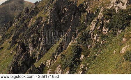 Sharp Rocky Mountain Ledges. Steep Mountain Descent.