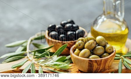 Set Of Green And Black Olives And Olive Oil On Gray Background. Different Types Of Olives In Olive W