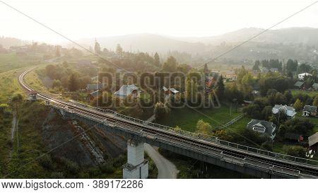 Topview Of Railway Bridge. Amazing Village In Mountains.