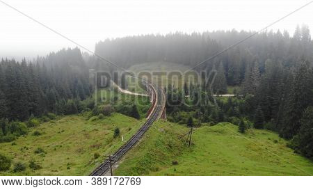 Aerial View Of Foggy Landscape With Railway Bridge. Famous Viaduct In Carpathians.