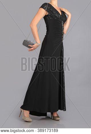 Girl In Beautiful Black Dress In Studio