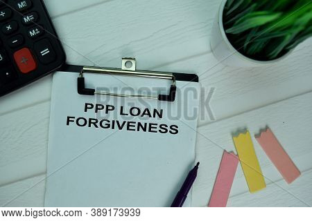 Ppp Loan Forgiveness Write On A Paperwork Isolated On Office Desk.