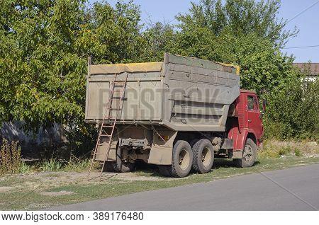 Nikolaev, Ukraine - September 21, 2020: Kamaz Dump Truck Stands On The Side Of The Road. Ladder At T