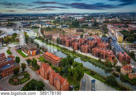 Gdansk, Poland - October 8, 2020: Architecture of the old town in Gdansk over Motlawa river at sunset, Poland.