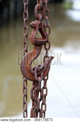 Antique Rust Of Steel Hook  Carry Steel Chain And Canal Background. To Gain Weight Of Something Heav