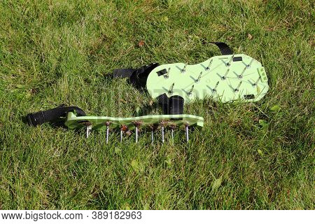 Spiked Shoes Liven Up The Lawn. Lawn Aeration. Gardening Concept. Garden Care.