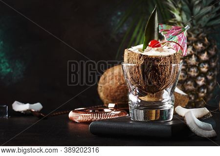 Pina Colada Cocktail In Chopped Coconut With Tropical Fruits And Bar Tools, Summer Relax Concept, Co