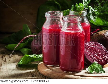 Vitamin Beetroot Smoothie In Glass Bottles On The Old Wooden Background, Selective Focus