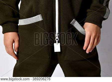Closeup Shot Zipper And Middle Part Detail Of Warm Green Winter Or Autumn Jumpsuit Attire For Kid. O