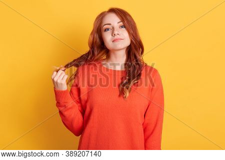 Unimpressed Indifferent Attractive Woman With Red Hair, Pulling Her Curls, Feeling Bored, Being On B