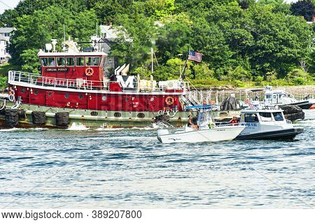 Portsmouth, New Hampshire - August 18, 2019: Boats Cruising In Portsmouth Harbor And In The Mouth Of