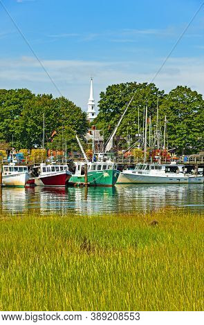 Portsmouth, New Hampshire - August 18, 2019: View Of The Banks Of Piscataqua River With Docked Boats