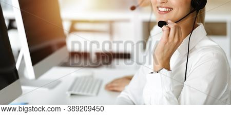 Unknown Female Customer Service Representative Iconsulting Clients Online Using Headset.close-up. Su