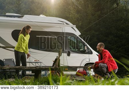 Motorhome Recreational Vehicle Vacation Time Road Trip. Romantic Summer Rv Van Camper Wilderness Cam