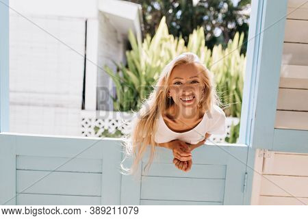 Excited Lightly-tanned Woman Having Fun With Inspired Smile. Photo Of Gorgeous Blonde Girl Posing Em