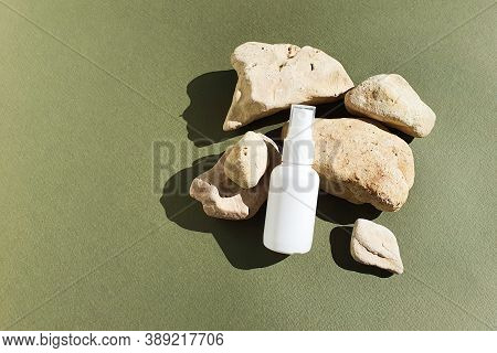Unbranded White Plastic Spray Bottle And Stones On A Dark Green Background.  Natural Organic Spa Cos