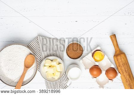 Baking Cake Or Pastry Or Cookies Ingredients On White Wooden Background. Top View Ingredients For Ba