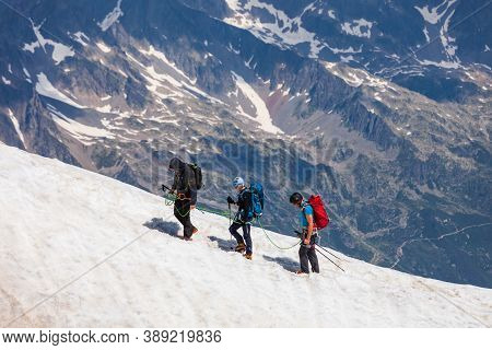 Chamonix, France - July 18, 2019: Unidentified Climbers Going To The Mont Blanc Or Monte Bianco Moun