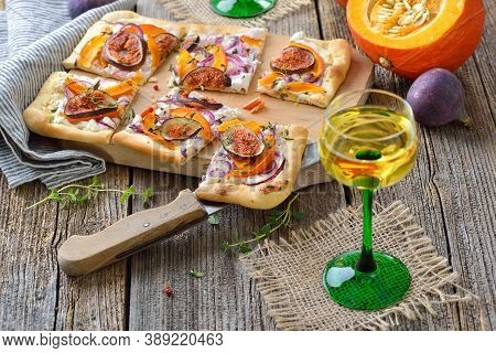 Tarte Flambee From Alsace With Goat\'s Cream Cheese, Onions, Slices Of Pumpkins And Figs, Served Wit