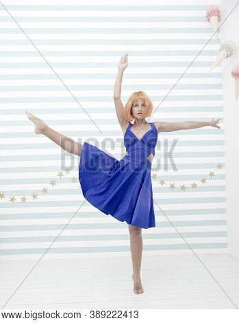 Dance Studio For Everyone. Crazy Woman In Dance Studio. Crazy Girl Dancer In Ballerina Pose. Woman D