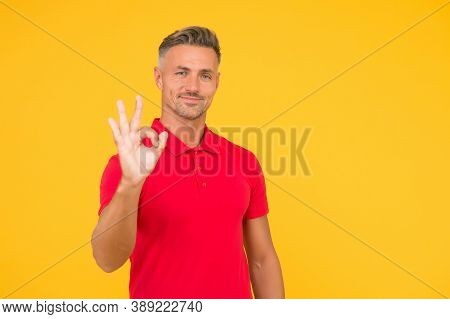 Everything Is Ok. Handsome Man Show Ok Yellow Background. Happy Guy Smile With Satisfaction. Agreed