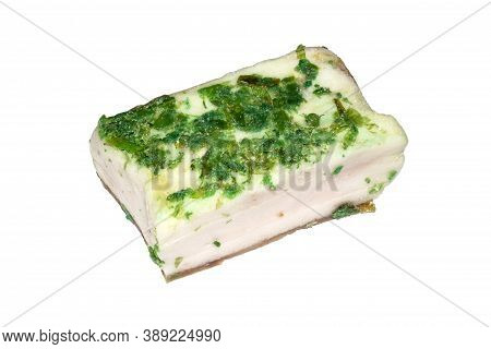 Homemade Ukrainian Lard With Garlic On A White Background.a Piece Of Lard With Herbs And Garlic.