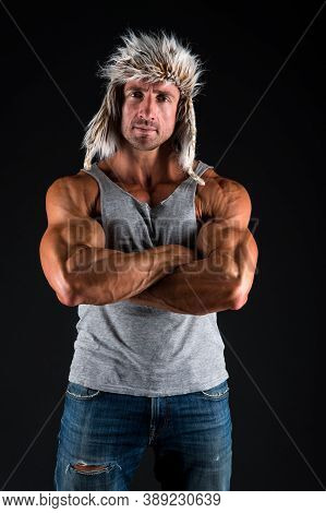 Triceps Workout For Stronger Arms. Strong Man Cross Arms With Biceps Triceps Black Background. Bodyb