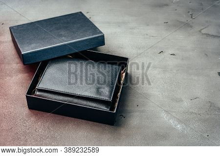 Black Leather Wallet On Grey Concrete Background