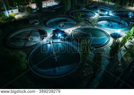 Aerial Night View Of Modern Wastewater Treatment Plant With Round Pools For Cleaning Sewage, Drone S