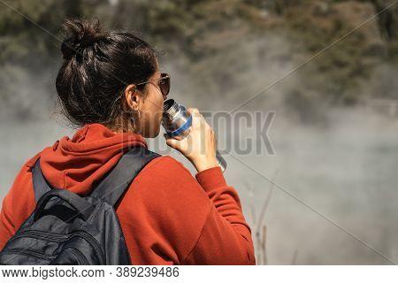 Woman Drinking Water While Touring In Hot Pools At Kuirau Park. Rotorua, New Zealand.