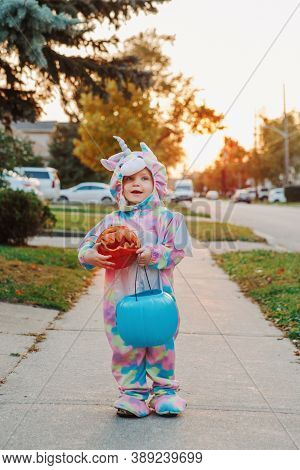 Trick Or Treat. Happy Baby Toddler With Red Pumpkin And Basket Going To Trick Or Treat On Halloween