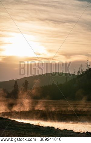 Steamy, Misty Morning Sunrise On The Madison River In Yellowstone National Park Wyoming