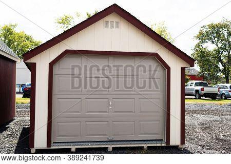 White New Detached Garage Door Fasade Empty