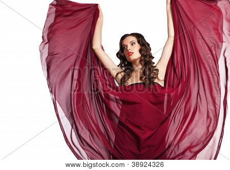 woman in red dress flying on wind isolated