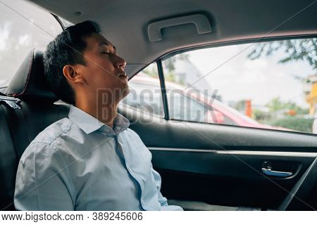 Tired Businessman Asleep In Back Seat Of Car, Resting, On The Move, Business Travel, Sleeping