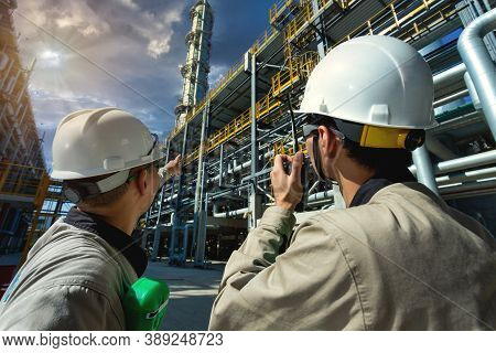 Industrial Engineer Or Worker Radio Communication To The Control Room At Oil And Gas Refinery Plant