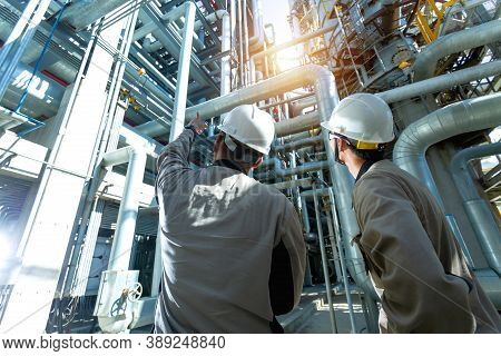Industrial Engineer Or Worker Checking Pipeline At Oil And Gas Refinery Plant Form Industry Zone Wit