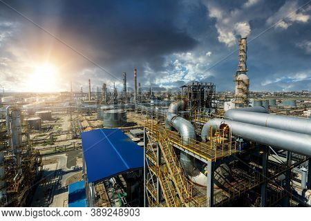 Industrial View At Oil And Gas Refinery Plant Form Industry Zone With Sunrise And Cloudy Sky, Oil An
