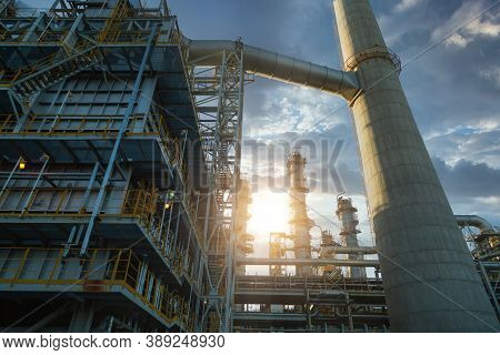 Close Up Industrial View At Oil And Gas Refinery Plant Form Industry Zone With Sunrise And Cloudy Sk