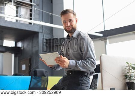 Young Businessman Using His Tablet In The Office.