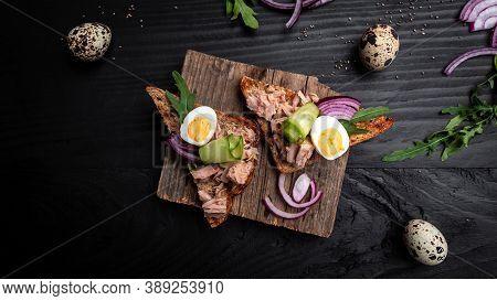 Tuna Salad Sandwiches On Chopping Board. Bruschetta Toast With Wholemeal Bread, Canned Tuna Fish, Qu