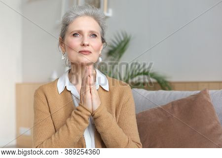 Middle Aged Woman Praying, Eyes Opened, Looking Up, Hoping For Best, Asking For Forgiveness.