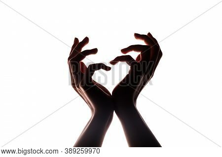 Love Symbol. Donation Charity. Female Hands Silhouette Holding Invisible Heart Isolated On White Cop